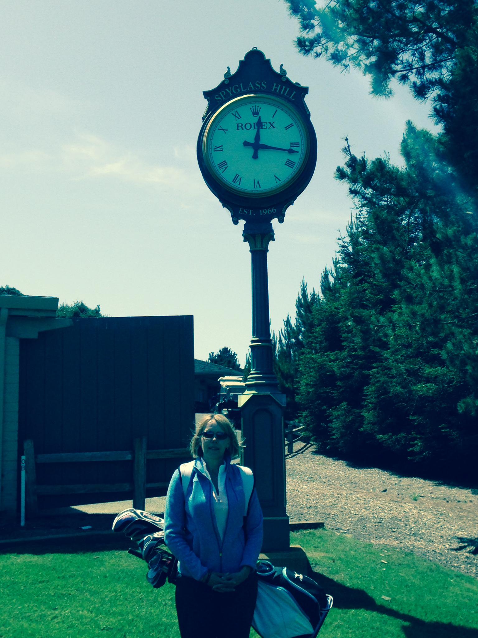 Manda in front of the clock